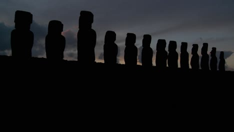 A-long-line-of-statues-is-silhouetted-on-Easter-Island