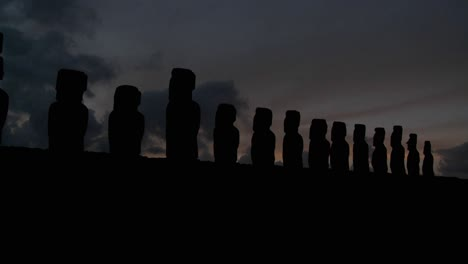 A-long-line-of-statues-is-silhouetted-on-Easter-Island-in-this-time-lapse-shot