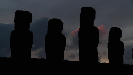 A-long-line-of-statues-is-silhouetted-on-Easter-Island-in-this-dusk-shot