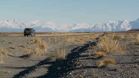 A-car-on-a-remote-road-heading-into-the-Andes-mountains-in-Patagonia-Argentina-1