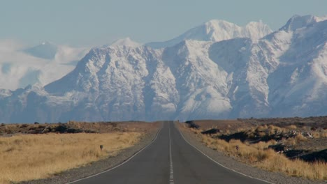 An-empty-road-heading-into-the-Andes-mountains-in-the-rmote-Argentine-region-of-Patagonia