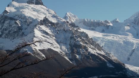 Pan-across-the-remarkable-mountain-range-of-Fitzroy-in-Patagonia-Argentina-with-snowclad-glaciers