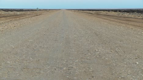 Pan-across-a-perspective-down-a-lonely-abandoned-road