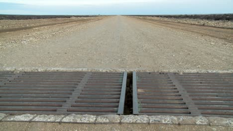 A-steel-metal-grate-cattle-guard-on-a-lonely-road