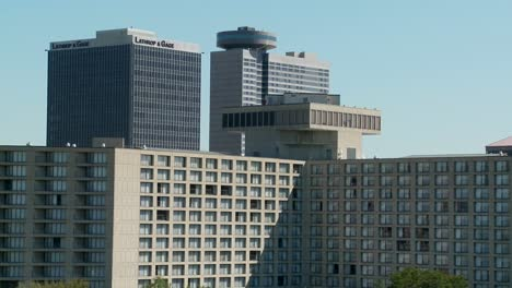 A-generic-conference-center-or-hotel-with-many-rooms-and-windows-with-tall-buildings-behind
