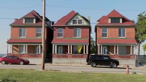 Three-tenement-houses-stand-together-in-an-urban-section-of-the-city-1
