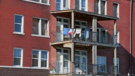 Laundry-blows-on-the-back-porch-of-a-tenement