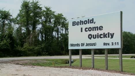 A-large-white-sign-quotes-Jesus-along-a-rural-roadway