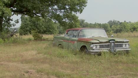 An-old-Ford-Edsel-sits-in-a-field