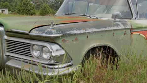 An-old-Ford-Edsel-sits-in-a-field-3