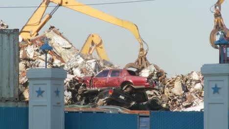 Cranes-lift-and-move-scrap-metal-around-abandoned-and-destroyed-cars-in-a-junkyard-or-scrap-metal-yard-1