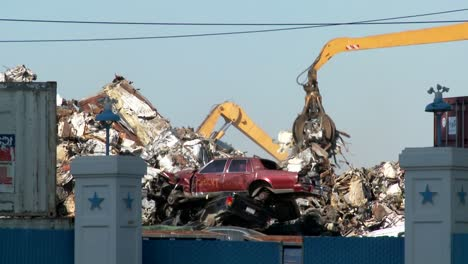 Cranes-lift-and-move-scrap-metal-around-abandoned-and-destroyed-cars-in-a-junkyard-or-scrap-metal-yard-2