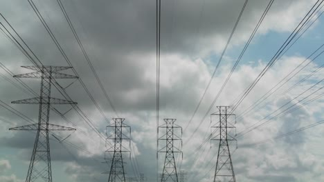 Time-lapse-of-clouds-moving-behind-high-tension-wires-and-power-lines-2