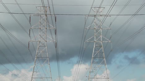 Time-lapse-of-clouds-moving-behind-high-tension-wires-and-power-lines-3