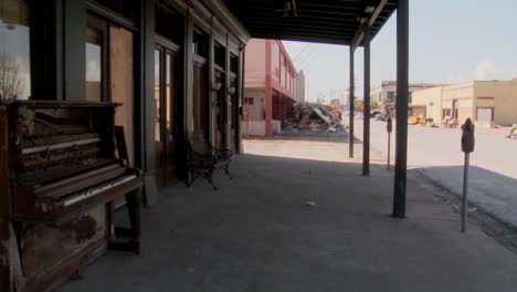 Pan-across-devastated-Galveston-street-after-Hurricane-Ike-and-an-old-piano-sitting-in-front-of-an-abandoned-bar