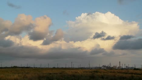 Time-Lapse-of-clouds-over-an-oil-refinery