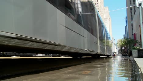 A-rapid-transit-train-moves-quickly-through-downtown-Houston-with-fountains-dancing-2