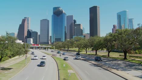 Cars-drive-along-a-highway-leading-into-downtown-Houston-1