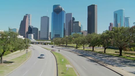 Cars-drive-along-a-highway-leading-into-downtown-Houston-2