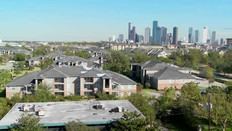 A-pan-across-a-suburban-area-of-Houston-with-the-downtown-distant