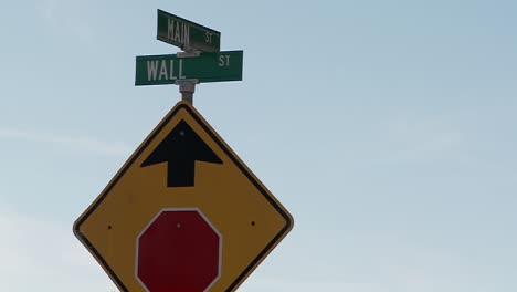 A-street-sign-indicates-the-intersection-of-Main-and-Wall-Streets-6