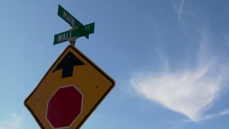 A-street-sign-indicates-the-intersection-of-Main-and-Wall-Streets-7