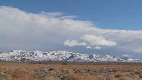 Time-lapse-over-snowclad-hills-in-the-Nevada-desert