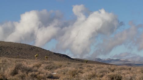 Time-lapse-of-clouds-moving-behind-a-ridge-in-the-desert