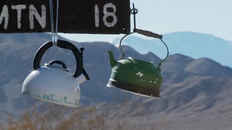 Tea-pots-hang-from-a-sign-in-Death-Valley-National-park