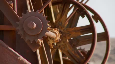 Old-cogwheels-rust-in-the-sun-at-an-abandoned-mine-1