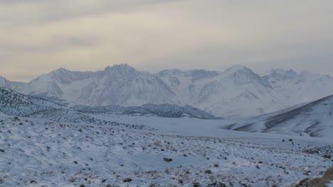 Winter-light-shines-down-on-a-snowy-Sierra-Nevada-landscape-1