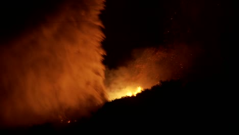 Firefighters-battle-a-raging-California-wildfire-at-night-by-performing-a-water-drop-from-an-aerial-tanker-1