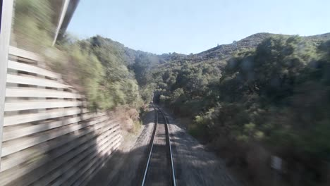 Exciting-POV-shot-point-of-view-of-a-train-down-tracks-and-into-a-tunnel