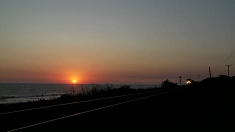 Beautiful-shot-of-an-Amtrak-train-passing-by-a-California-beach-at-sunset-1