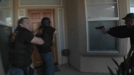 DEA-officers-with-arms-drawn-perform-a-drug-raid-on-a-house-4