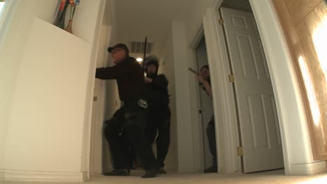 A-SWAT-team-with-DEA-officers-clears-a-house-during-a-drug-raid-1