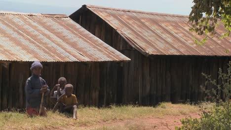African-children-sit-near-a-slum