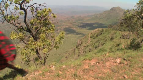 A-Masai-warrior-walks-along-the-edge-of-the-world-in-Northern-Kenya