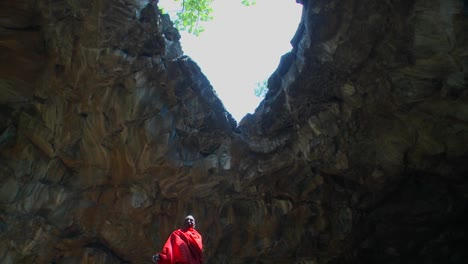 Majestic-shot-of-a-Masai-warrior-standing-in-a-cave-in-Kenya