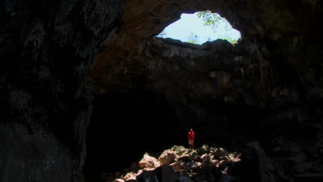A-Masai-warrior-is-bathed-in-a-pool-of-light-in-a-cave-in-Kenya