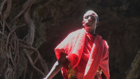 A-young-Masai-man-standing-in-a-pool-of-light-in-a-cave-in-Kenya