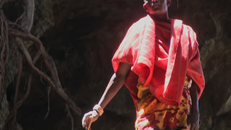 A-young-Masai-boy-stands-bathed-in-a-pool-of-light