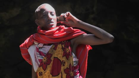 A-Masai-man-in-tribal-costume-talks-on-a-cell-phone