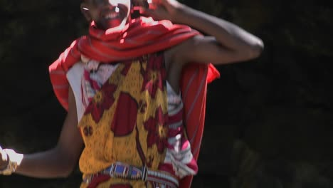 Tilt-up-to-a-Masai-man-speaking-on-a-cell-phone