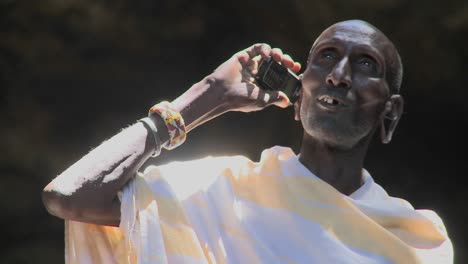 An-old-Masai-man-speaks-to-friends-on-a-cell-phone