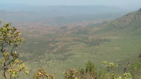 A-Masai-warrior-standings-at-the-edge-of-a-canyon-in-Northern-Kenya