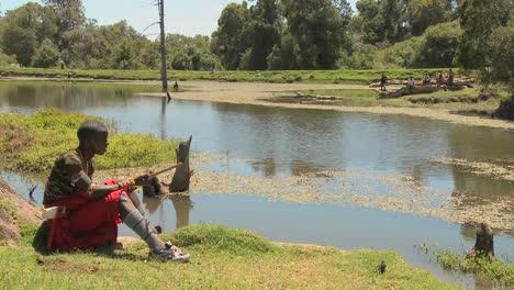A-young-masai-boy-sits-beside-a-lake-in-Northern-Kenya