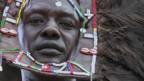 An-extreme-close-up-of-a-face-of-a-Masai-warrior-with-full-headdress