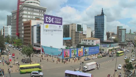 Wide-shot-of-downtown-Nairobi-Kenya-with-traffic-and-pedestrians