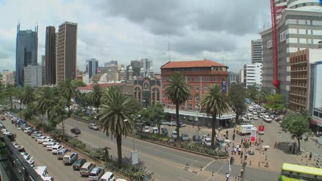 Wide-shot-of-downtown-Nairobi-Kenya-with-traffic-and-pedestrians-1